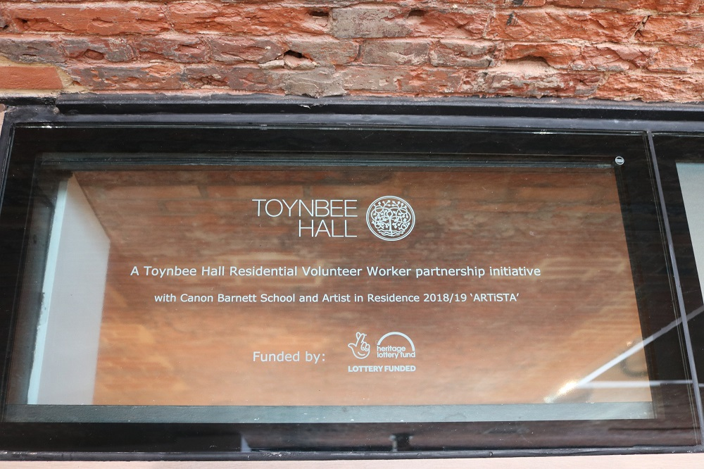 Glass Plaque commemorating the project and partnership between Toynbee Hall and Canon Barnett Primary school